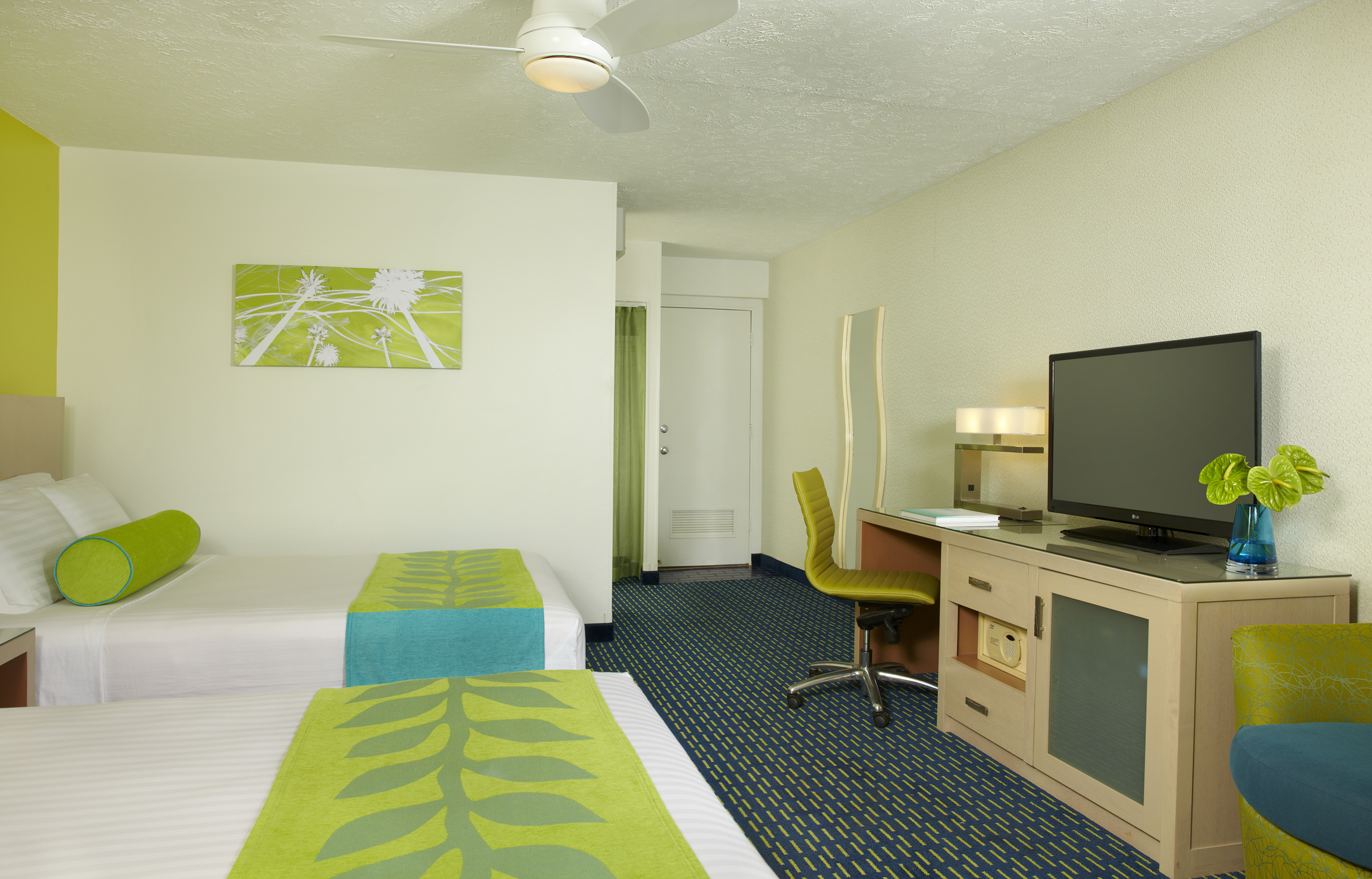 King size bed, TV and table decoration of the room