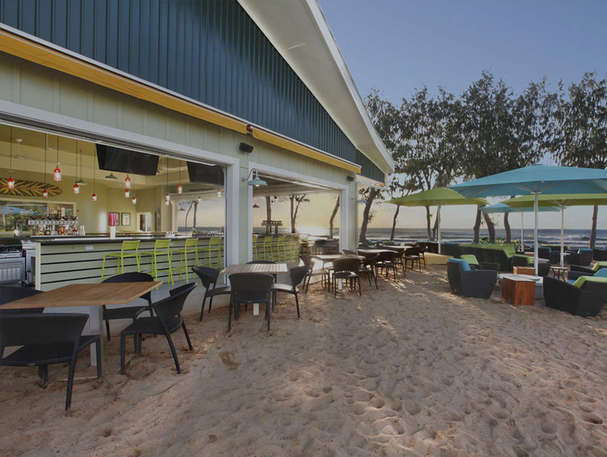 restaurant on the beach with table and chairs